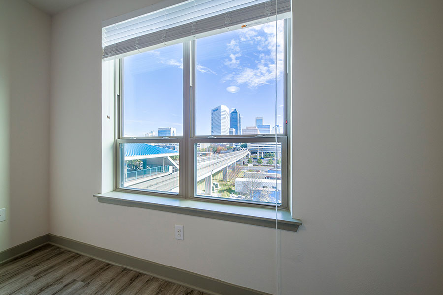 apartment window overlooking city skyline