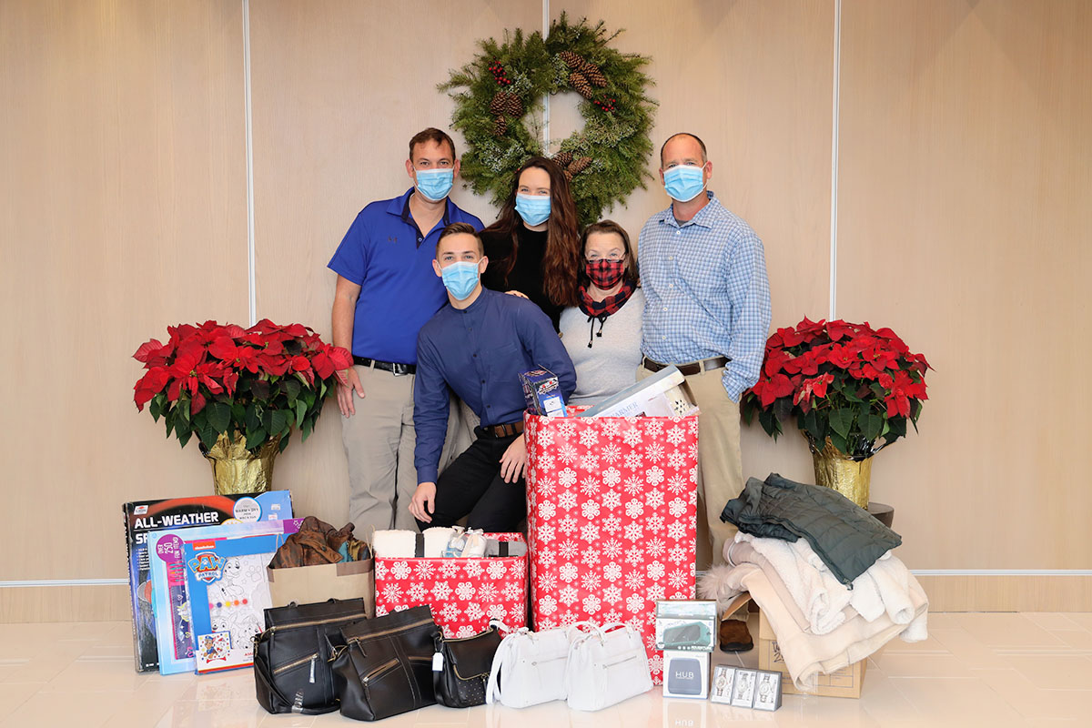 group of people with holiday donations