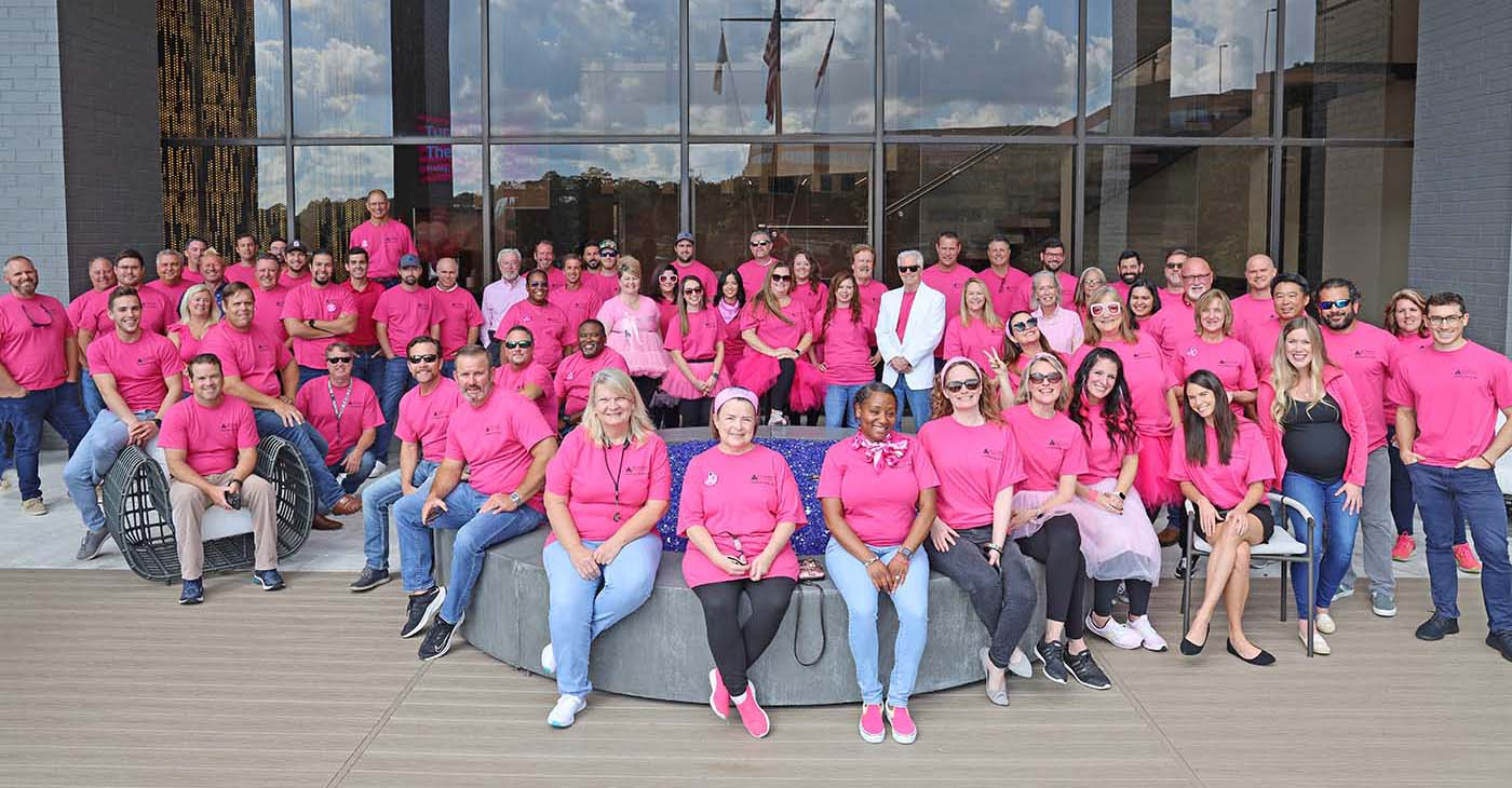 Summit Contracting Group wearing pink for Breast Cancer Awareness